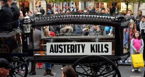 A horse-drawn carriage leading an anti-austerity march in O'Connell Street, Dublin, in 2013. File photograph: Eric Luke