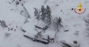 A handout picture provided by the Italian Fire Department shows an aerial view of Hotel Rigopiano after it was hit by an avalanche. Photograph: EPA/Italian Fire Department