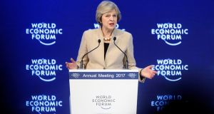 "Theresa May at the World Economic Forum  in Davos: ""We are by instinct a great global trading nation that seeks to trade with countries not just in Europe but beyond Europe too."" Photograph: Laurent Gillieron/EPA"