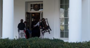 Furniture is moved out of the West Wing of the White House on Wednesday. Photograph: AFP/Nicholas Kammicholas Kamm/Getty.