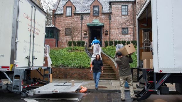 Movers taking President Barack Obama's family's belongings into their rented house in the Kalorama neighborhood of Washington on Tuesday. Photograph: AP/Cliff Owen