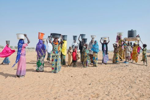 Women carry water back to their homes in a village near Zinder, Niger. The Irish Red Cross, which has had a presence in Niger since 2005, supported the construction of a borehole and pump in the village.