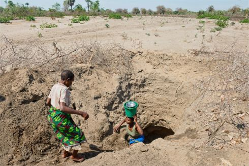 "Abiti Anesi (65) and her daughter Esita (46) fetch water from an open well under a dried river bed in the Chikwawa district of Malawi. ""We have two sources of water,"" says Abiti. ""The water from the open well is sweet but not clean. The water from the bore hole is salty""."