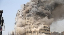 High-rise Tehran landmark collapses on live television