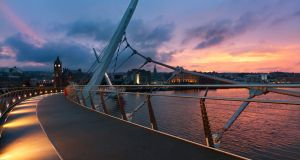 The Peace Bridge over the river Foyle  in Derry. Bemis plans to have 95 new jobs in place in the city  by 2021. Photograph: iStock