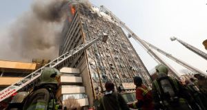 Firefighters battle a blaze that destroyed Iran's oldest high-rise, the Plasco Building in downtown Tehran. Photograph: Ho and Strho/AFP/Getty Images