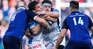 Castres' Antoine Dupont is tackled by Jamie Heaslip of Leinster during the game at the RDS. Photograph: Tommy Dickson/Inpho