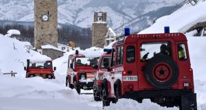 Firefighters' vehicles in Amatrice after a series of  earthquakes struck the Abruzzo region of Italy. Photograph: Andreas Solaro/AFP/Getty Images