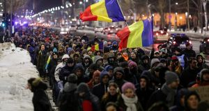 Romanians protest against government plans in Bucharest on Wednesday. Photograph: Octav Ganea via Reuters