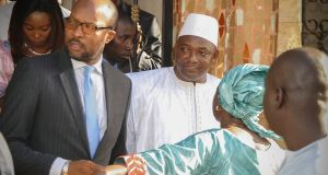 President-elect of Gambia Adama Barrow (centre) after he was sworn in as president at the Gambia embassy in Dakar, Senegal,  January 19th, 2017. West African military forces are moving in to enforce the transfer of power in Gambia, removing President Yahya Jammeh following his refusal to accept election results. Photograph: EPA