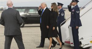 President-elect of the United States, Donald J Trump, and his wife Melania Trump arrive at Joint Base Andrews the day before his swearing in. Hundreds of thousands of people are expected to come to the National Mall to witness Mr Trump being sworn in as the 45th president of the United States. Photograph: Chris Kleponis/Getty Images