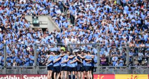 The Dublin team gather in a huddle in front of Hill 16 ahead of the Leinster football final against Westmeath last July. Photograph:  Tommy Grealy/Inpho
