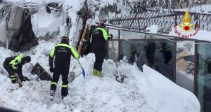 Firefighters work at Hotel Rigopiano in Farindola after it was hit by an avalanche. Photograph: Reuters/Vigili del Fuoco