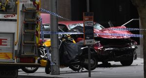 Police and emergency services at the scene where a man went on a rampage in a car through busy area in Melbourne. Photograph: Julian Smith/ EPA