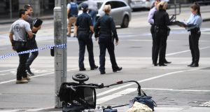 A pram is seen on the corner of Bourke and William Street. Photograph: Julian Smith/EPA