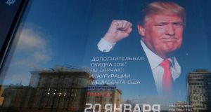 The shop 'Army of Russia', located opposite the US embassy in Moscow, with an image of US president-elect Donald Trump. Photograph: Reuters