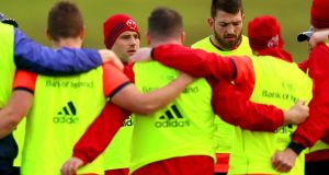 CJ Stander and Jean Kleyn stand shoulder to shoulder with their Munster team-mates. Photograph: James Crombie/Inpho