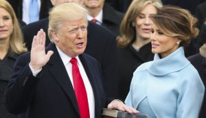 Donald Trump is sworn in as the 45th president of the United States as Melania Trump looks pn. Photograph: Andrew Harnik/AP