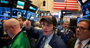 A trader wears a Donald Trump hat on the floor of the New York Stock Exchange. The Dow advanced in early trading.