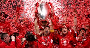 Steven Gerrard lifts the Champions League trophy after Liverpool's victory over AC Milan in Istanbul in 2005. Photograph:  Phil Noble/PA Wire