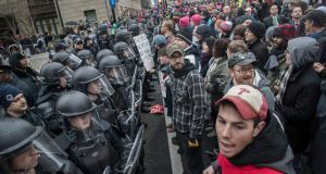Riot police hold a line against protesters attempting to block an entrance to the National Mall as they rally against the inauguration of Donald Trump. Photograph: The New York Times