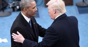 "Barack Obama  and Donald Trump: one strategist says ""Mr Trump's trade policies could backfire rapidly"". Photograph: Brendan Smialowski/AFP/Getty Images"