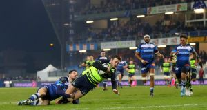 Leinster's Robbie Henshaw scores the first of his two tries  despite the tackle of Julien Dumora of Castres during the Champions Cup game at Stade Pierre Antoine. Photograph: James Crombie/Inpho