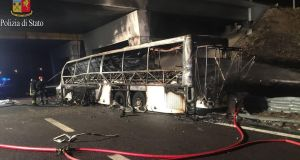 A handout photo made available by Polizia Di Stato (Italian State Police) shows a burned Hungarian bus after an accident at a motorway exit near Verona, Italy, on Saturday. Photograph: EPA