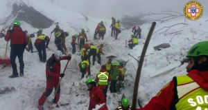Italian mountain rescue  workers search the   rubble of the  Hotel Rigopiano, in the Gran Sasso mountains, 180km  northeast of Rome. Photograph: EPA