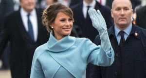 First lady Melania Trump waves to supporters in the inaugural parade on January 20, 2017 in Washington, DC. Photograph: Kevin Dietsch/Getty Images