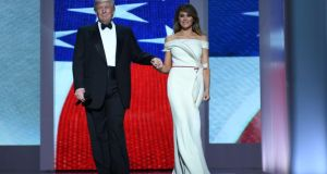 US President Donald Trump and the first lady Melania Trump enter the Liberty Ball at the Washington DC Convention Center following Donald Trump's inauguration as the 45th President of the United States. Photograph: Jim Watson/AFP/Getty Images