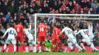 Swansea City's Spanish striker Fernando Llorente wheels away to celebrate scoring at Anfield. Photograph: Getty Images
