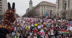 Thousands of people on Pennsylvania Avenue gather in the Women's March and rally to protest President Donald J Trump the day after he was sworn in as the 45th President of the United State. Photograph:  Epa/Michael Reynolds