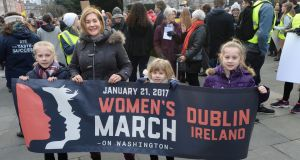 Alana Kirk with her daughters at the Women's March in Dublin on Saturday. Photograph: Dara Mac Dónaill/The Irish Times