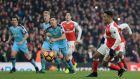 Arsenal's Alexis Sanchez chips in his late penalty at The Emirates Stadium. Photograph: PA