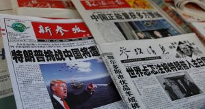 "Newspapers in Shanghai on Saturday. The People's Daily said  punitive tariffs and labelling China a ""currency manipulator"" would  lead only to retaliation. Photograph: Reuters"