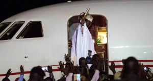 Gambia's defeated leader Yahya Jammeh waves to supporters as he departs from Banjul airport.  Photograph: Jerome Delay/AP Photo