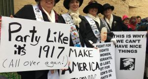 Andrea Beaty (55), her daughter and her two sisters, who travelled from North Carolina and California, were dressed in the purple and white of early 20th century Suffragettes to protest.