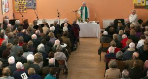 Fr Tony Flannery addresses  the congregation during a Mass to mark his 70th birthday, at Killimordaly Community Hall, Co Galway on Sunday. Photograph: Joe O'Shaughnessy