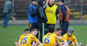 Clare players, Donal Moloney, Gerry O'Connor and Donal Og Cusack gather after the game. Photograph: Ken Sutton/Inpho