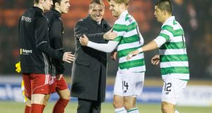 Celtic's Stuart Armstrong with manager Brendan Rodgers after the match at the Excelsior Stadium. Photograph: PA