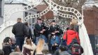 Members of the Clew Bay Pipe Band on the Halpenny Bridge to announce details of the Trad Fest Temple Bar.Photograph: Cyril Byrne/The Irish Times