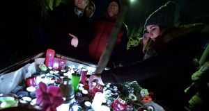 Candles and flowers are placed at the Szinyei Merse Pal High-school in Budapest  to commemorate the victims of the bus crash. Photograph: Getty