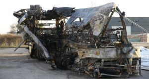 The burned Hungarian bus after the crash at  'Verona Est' highway's exit in Verona. Photograph: EPA