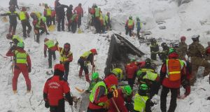 Rescue teams working at the avalanche-hit Hotel Rigopiano, near the village of Farindola, on the eastern lower slopes of the Gran Sasso mountain.  Italian rescuers pulled nine survivors from the hotel. Photograph: CNAS/AFP