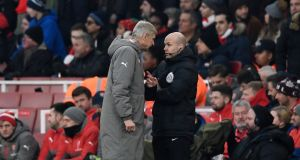 Arsenal manager Arsene Wenger clashes with fourth official Anthony Taylor during the Premier League game against Burnley. Photograph:  Dylan Martinez/Reuters/Livepic