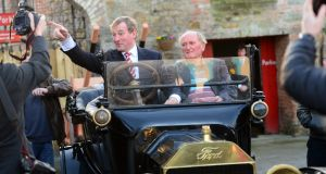 RURAL DEVELOPMENT: Taoiseach Enda Kenny in a 1916 Ford Model T, after the launch of the action plan for rural Ireland in Ballymahon, Co Longford. Photograph: Dara Mac Dónaill/The Irish Times