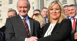 Martin McGuinness and his successor Michelle O'Neill  at Stormont on Monday. Photograph: Colm Lenaghan/Pacemaker