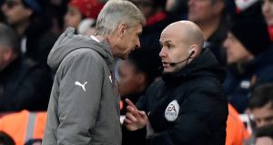 Arsenal manager Arsene Wenger clashes with fourth official Anthony Taylor before being sent to the stands. Photograph:  Dylan Martinez/Reuters