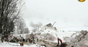 An excavator at the site of the avalanche-buried Hotel Rigopiano, near Farindola. Italy. Photograph: ANSA/AP